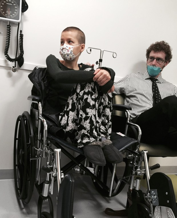 Johanna and Scott wait during a recent doctor's appointment. (Coutesy photo/Rochester Post-Bulletin)