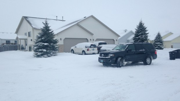 A Fargo police SUV stands outside a residence where a search warrant reportedly was executed Tuesday, Jan. 10, 2017, in connection with a U.S. Capitol Police investigation. (Forum News Service: Dave Olson)