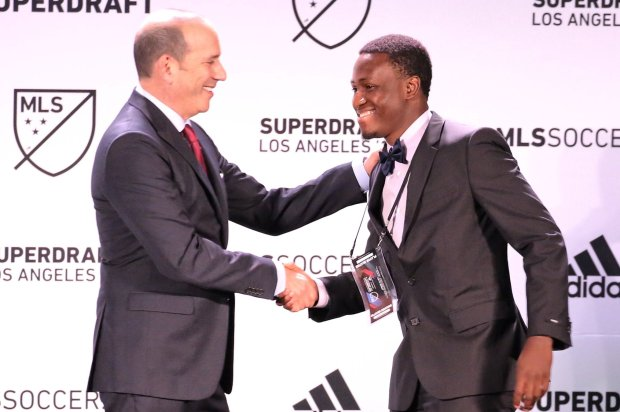 Abu Danladi, Minnesota United's top pick in Major League Soccer's SuperDraft, shakes hands with MLS commissioner Don Garber on Friday at the Los Angeles Convention Center. (Photo courtesy of Major League Soccer)