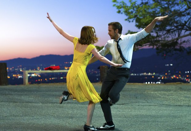 """This image released by Lionsgate shows Ryan Gosling, right, and Emma Stone in a scene from, """"La La Land."""" The film was nominated for an Oscar for best picture on Tuesday, Jan. 24, 2017. The 89th Academy Awards will take place on Feb. 26. (Dale Robinette/Lionsgate via AP)"""