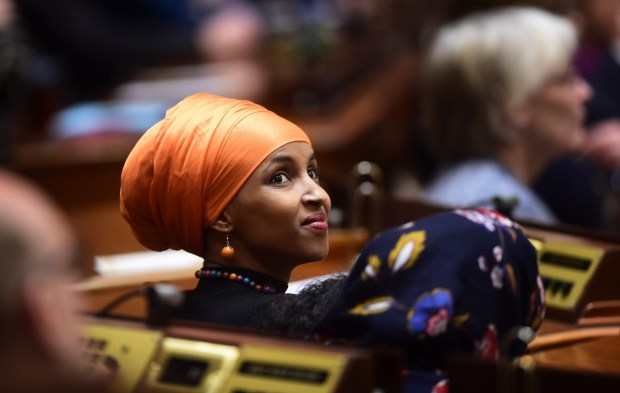 New legislator Ilhan Omar, DFL-Minneapolis, looks around from her seat on the floor of the Minnesota House as the 2107 Legislature convened at the State Capitol in St. Paul on Tuesday, Jan. 3, 2017. Omar is the nation's first elected Somali-American lawmaker. (Pioneer Press: Scott Takushi)