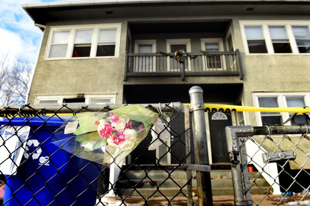 Flowers are placed in the fence in front of a four-plex at 1035 Arkwright Street in St. Paul on Thursday, Jan. 26, 2017. A fatal fire at the building Wednesday killed Tiffany Alexander, 27. Relatives said Thursday that her two-year-old son William, severely injured in the fire, had also died. (Pioneer Press: Scott Takushi)