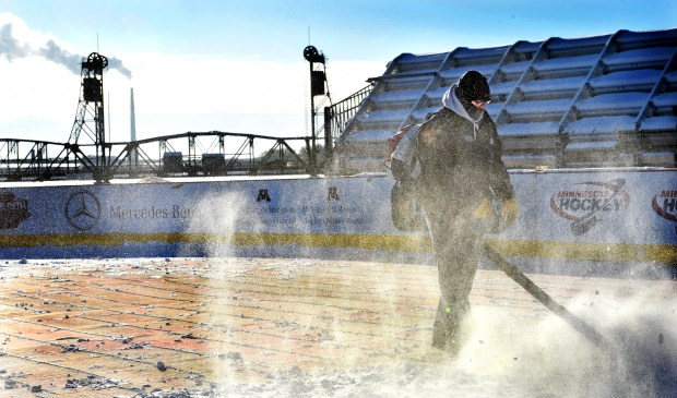 Mark Howe, a volunteer from Stillwater, blows snow off the rink to get it ready to flood as work continues Thursday, Jan. 12, 2017, on the outdoor rink for Hockey Day Minnesota in Stillwater.  (Pioneer Press: Jean Pieri)