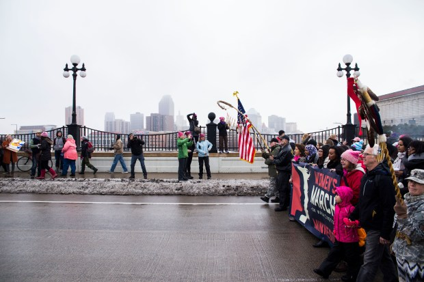 Demonstrators hold a banner, leading the front during the Women's March Minnesota in St. Paul on Saturday, Jan 21, 2017, where an estimated 90,000 to 100,000 people rallied in solidarity to stand up for women's rights following the inauguration of President Donald Trump. (Special to the Pioneer Press: Liam James Doyle)