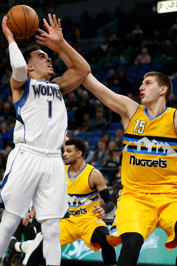 Minnesota Timberwolves guard Tyus Jones (1) looks up to the basket against Denver Nuggets center Nikola Jokic (15) in the first half of an NBA basketball game, Sunday, Jan. 22, 2017, in Minneapolis. (AP Photo/Stacy Bengs)