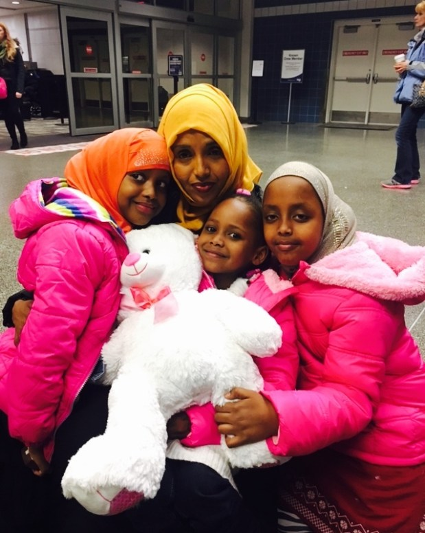 Samira Dahir, top center, welcomes her daughter Mushkaad Abdi, center, to the Twin Cities on Thursday, Feb. 2, 2017. With them are Dahir's two older daughters, Muwatib, 8, and Mumtaz, 7. (Photo courtesy Sen. Al Franken's office)