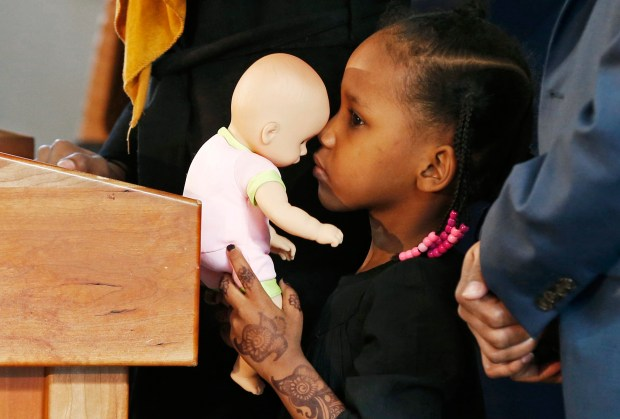 Four-year-old Somali refugee Mushkaad Abdi holds her doll as her mother, Samira Dahir, talks during a Minneapolis news conference Friday, Feb. 3, 2017, one day after she was reunited with her family. Her trip from Uganda to Minnesota was held up by President Donald Trump's Jan. 27 order barring refugees from seven predominantly Muslim nations. (AP Photo/Jim Mone)