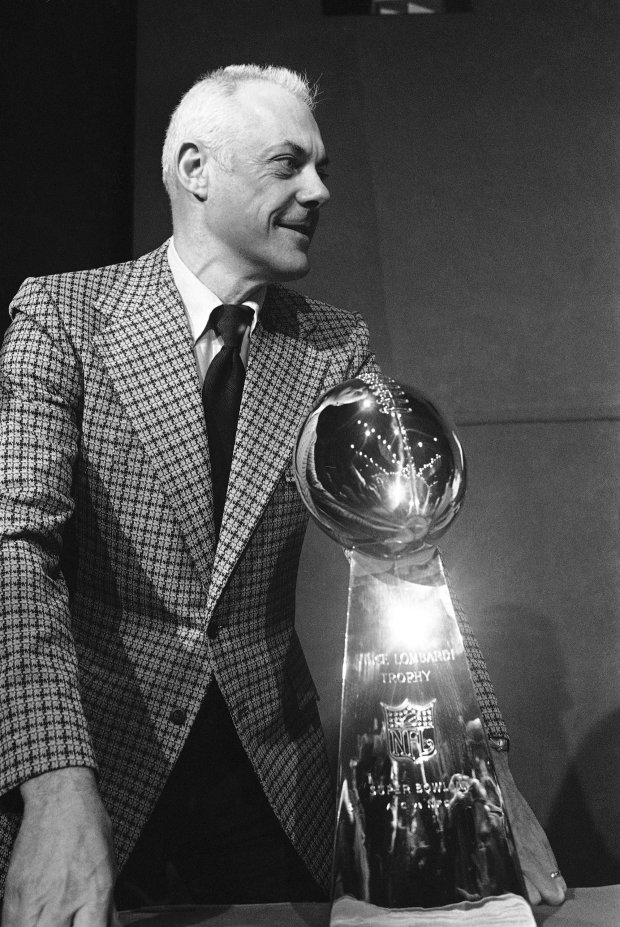 Coach Bud Grant of the Minnesota Vikings, posed with the Super Bowl trophy in Houston on Friday, Jan. 11, 1974. Shula won last year and hopes to repeat in game against the Vikings at Rice Stadium on January 13. Grant hopes for his first win on his second try for pro football?s top title. (AP Photo/CK)