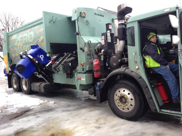 A Eureka Recycling truck empties a lidded cart on Charles Avenue in St. Paul on Jan. 20, 2017. Through a five-year contract with the city of St. Paul, Eureka Recycling collects recyclables from residential alleys. The contract began Jan. 16, 2017 but pick-ups have been delayed due to icy alley conditions, incomplete GIS maps and errors in cart placement. Frederick Melo/Pioneer Press