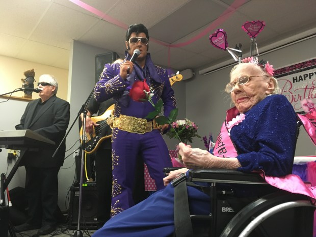 """Elvis"" (Eddie Hughes of Echo's of Elvis) serenaded Betty Nordin on her 105th birthday on Feb. 18 at the offices of Wingspan Life Resources in St. Paul. (Pioneer Press: Molly Guthrey)"