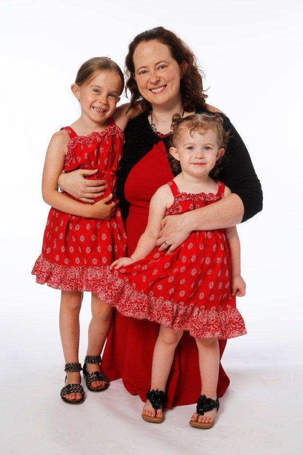 Melanie McIvor with her daughters, Ainsley (left), 6, and Aili, 3. Courtesy of American Heart Association/Tim Rummelhoff Photography