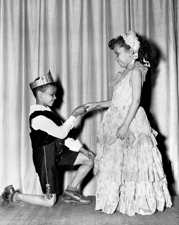"""An image from Hallie Q. Brown children's production of """"Snow White"""" in 1948. As a community center formed by the Twin Cities Urban League in 1929, Hallie Q. Brown provided social services for African Americans. By the 1970s, its offerings included everything from homework help to exercise classes to culturally relevant programs in the visual arts, music, dance, and theatre. In 1976, Lou Bellamy was hired to expand the theatre program at the community center. The following year he founded Penumbra Theatre Company and became its artistic director. Photo courtesy of the Minnesota Historical Society."""