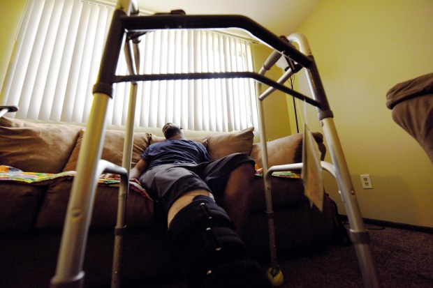Darrell Whitmore squirms in pain on a sofa inside a relative's home in St. Paul on Thursday, Feb. 23, 2017. Whitmore, 29, was shot in the leg inside Stargate nightclub Saturday. No arrests have been made, and even though Whitmore never saw the shooters, he didn't want his face recognizable in pictures to protect his safety. (Pioneer Press: Dave Orrick)