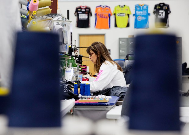 Marlene Kramer works at a sewing machine for a custom sportswear company in Prairie du Chien, Wis., Thursday, Jan. 19, 2017. Since the company doesn't provide health insurance, Kramer said she's glad that the Affordable Care Act has helped millions get insurance and saved lives. But it hasn't helped hers. She and her husband were stunned to see premiums over $1,000 per month. It's cheaper for them to pay the penalty of $2,000 and forgo health insurance, and they pray they don't get sick before Trump, she hopes, keeps his promise to replace the law with something better. (AP Photo/David Goldman)