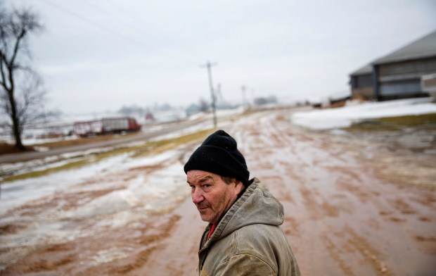 Bernard Moravits walks on his farm in Bloomington, Wis., Thursday, Jan. 19, 2017. Moravits works on his 10,000 acres at least 12 hours every day, and usually a lot longer. He diversified to minimize risk and now farm dairy cows and beef cows, corn, beans, alfalfa. The price of milk and other agricultural goods has plummeted, and it's getting harder to keep things running, he said. Change is what he looked to Obama for and now expects from Trump. (AP Photo/David Goldman)
