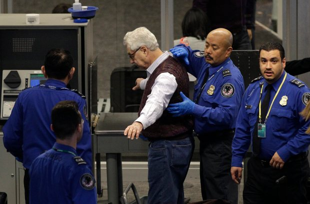 a transportation security administration tsa officer pats down elliott erwitt as he works his - Transportation Security Officer