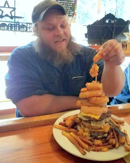 "Austin Kiekhafer, 24, of North Branch, was the first to conquer Meister's Bar and Grill's ""Two Pounder."" He downed the sandwich on March 21, 2017. (Courtesy of Meister's Bar and Grill)"