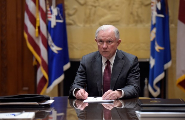 In this Feb. 9, 2017, file photo, Attorney General Jeff Sessions holds a meeting with the heads of federal law enforcement components at the Department of Justice in Washington. Sessions had two conversations with the Russian ambassador to the United States during the presidential campaign season last year, contact that immediately fueled calls for him to recuse himself from a Justice Department investigation into Russian interference in the election. The Justice Department said Wednesday night, March 1, 2017, that the two conversations took place last year when Sessions was a senator. (AP Photo/Susan Walsh, Pool, File)