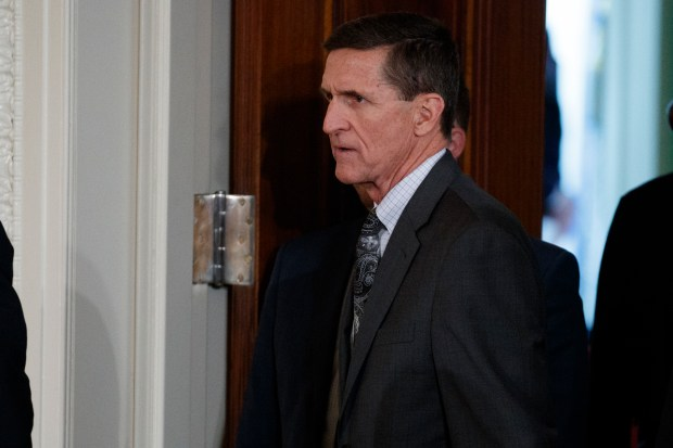 In this Feb. 13, 2017 photo, Mike Flynn arrives for a news conference in the East Room of the White House in Washington. Flynn, President Donald Trump's former national security adviser, who was fired from the White House last month, has registered as a foreign agent with the Justice Department for work that may have aided the Turkish government in exchange for $530,000.  (AP Photo/Evan Vucci, File)