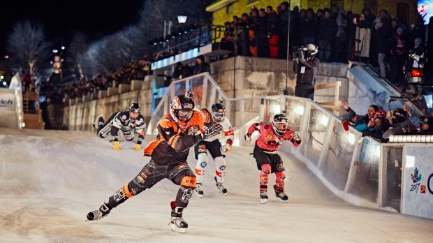 Lakeville native Cameron Naasz leads in the final heat ahead of Dean Moriarity of Canada (right), Jim DePaoli of Switzerland (middle back) and Scott Croxall of Canada at the eighth stage of the Ice Cross Downhill World Championship at the Red Bull Crashed Ice race in Ottawa, Canada on March 4, 2017. (courtesy photo)