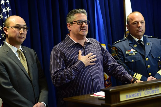 Mark Kuller, center, is joined by Ramsey County Attorney John Choi, left, and St. Paul Police Chief Todd Axtell, during a St. Paul news conference Thursday, March 16, 2017, announcing an arrest in the death of his grandmother, Lillian Kuller. Michael Anthony Withers, 58, a prisoner at the Minnesota Correctional Facility in Stillwater, was charged in Ramsey County District Court on March 16, 2017, with one count each of second-degree murder with intent and second-degree murder without intent in connection with the 1987 death of Lillian Kuller. Kuller, 81, was found Feb. 1, 1987, strangled in her apartment at 1290 Goodrich Ave. in St. Paul. Scott Takushi / Pioneer Press.
