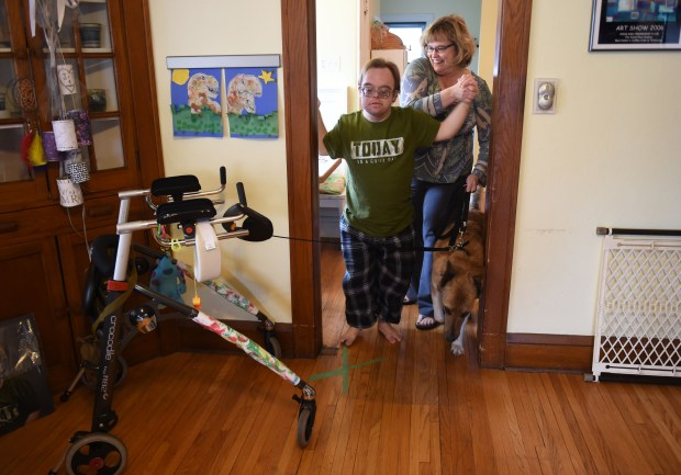 David Bender, 30, gets ready to take a walk outside with his mother Jean and dog Tooti, at his home in St. Paul, Wednesday, March 29, 2017. Bender receives Medicaid payments which provides for some of his assistant's funding. Scott Takushi / St. Paul Pioneer Press