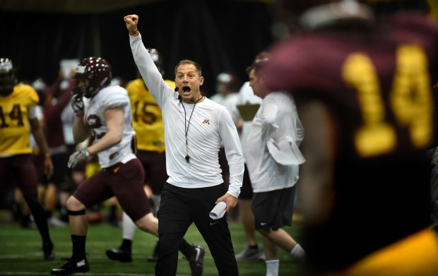 Minnesota head coach P.J. Fleck talks to his team at football practice in Gibson-Nagurski Football Complex in Minneapolis on Thursday, March 23, 2017. (Jean Pieri / Pioneer Press)