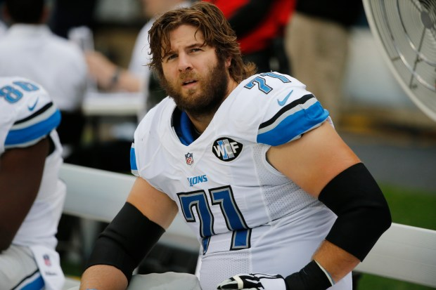 Detroit Lions tackle Riley Reiff looks at the scoreboard during the first half of an NFL football game, Sunday, Oct. 2, 2016, in Chicago. (AP Photo/Charles Rex Arbogast)
