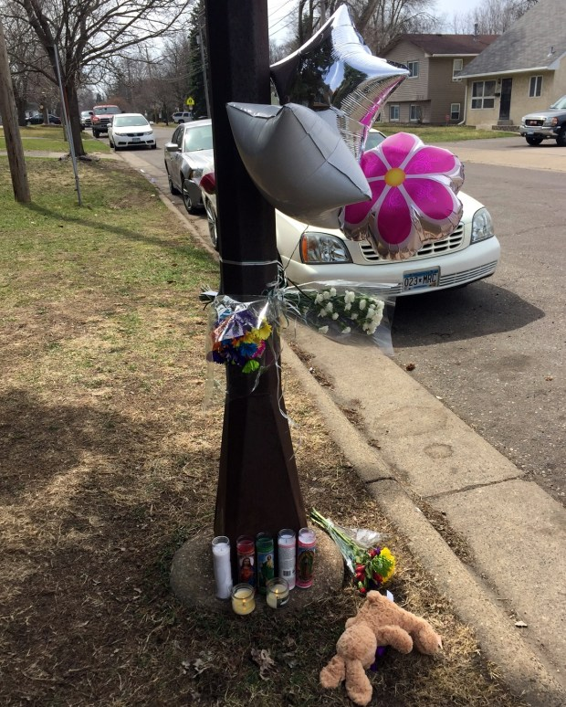 Memorial items are left outside the apartment where Wade McIntosh and daughters Maria and Olivia were fatally shot early Friday, April 7, 2017. (Will Ashenmacher / Pioneer Press)