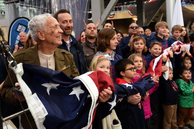 World War II veteran Henry Langevin, 94, of Roseville gets ready to raise the flag before the Minnesota Twins' home opener against Kansas City at Target Field in Minneapolis on Monday, April 3, 2017. (Scott Takushi / Pioneer Press)