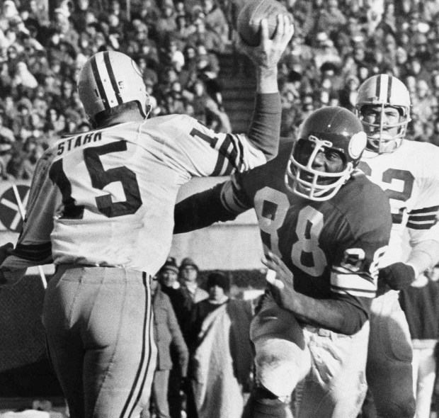 Green Bay Packers quarterback Bart Starr (15) looks for a receiver as the Vikings' Alan Page (88) charges him during second half action of a Nov. 23, 1970, game in Minneapolis. From the NBA's Chris Dudley and Shawn Bradley to the NFL's Alan Page, Heath Shuler and Jon Runyan to pro wrestling's Linda McMahon, some two dozen sports figures are up for election. (AP Photo/File)