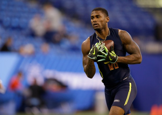 Miami wide receiver Stacy Coley runs a drill at the NFL football scouting combine in Indianapolis, Saturday, March 4, 2017. (AP Photo/Michael Conroy)