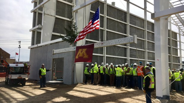 Workers raise the final structural beam for the University of Minnesota's Athletes Village, a $166 million project scheduled to open in about nine months in Minneapolis, on Friday, April 28, 2017. The beam is part of an indoor practice facility for the football team and was raised at a ceremony attended by donors, players and members of the athletics department. (Dane Mizutani / Pioneer Press)
