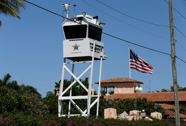 In this Friday, April 7, 2017, photo, a Palm Beach County Sheriff's lookout tower sits outside of President Donald Trump's Mar-a-Lago resort, in Palm Beach, Fla. Commissioners in Palm Beach County are so tired of spending money on President Donald Trump's frequent visits to his Mar-a-Lago resort, some are suggesting a special tax be levied against the property. Trump's visits have cost Palm Beach County taxpayers about $2 million. (Associated Press/Lynne Sladky)