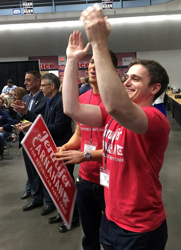 Tony Lazzaro (left) and Matt Noel cheer after Jennifer Carnahan was elected the chair of the Republican Party of Minnesota on Saturday, April 29, 2017. (David H. Montgomery/Pioneer Press)