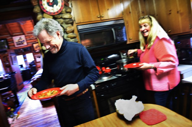 """I really do help, even if I'm ADHD,"" said Doug Wood as he brings his wife Kathy's homemade vegetable beef soup to the table for lunch. The two met at Morningside College in Sioux City, Iowa, where Doug thought Kathy Sokolowski ""was the prettiest girl in the music department."" (Jean Pieri / Pioneer Press)"