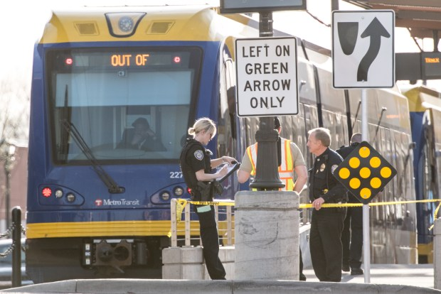 Police stand outside a stopped Green Line train at University Avenue and Dale Street in St. Paul following a shooting at the light rail platform Monday, April 17, 2017. The shooting stopped train traffic at the intersection for more than two hours. (Pioneer Press / Andy Rathbun)