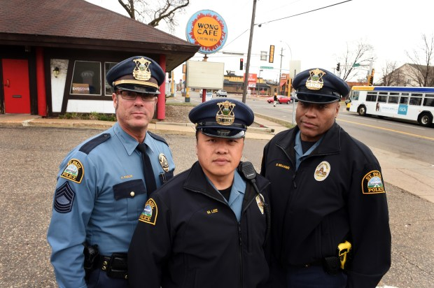 Investigators in the Hang Lee case are from left: St. Paul Sgt. Paul Paulos, Officer Mong Lee and Officer Benny Williams, standing at the corner of Rice Street and Wheelock Parkway in St. Paul, at the intersection where suspect Mark Wallace reported he dropped off Hang Lee in 1993, photographed April 5, 2017. At the time, Lee worked at the Wong Cafe. Scott Takushi / Pioneer Press