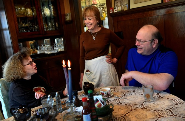 Carla Solberg Sherman, center, proprietor at the Como Lake B&B in St. Paul, talks with her guests Karen and Craig Smith from Rochester during breakfast on Thursday, April 20, 2017. St. Paul bed and breakfast owners say they're held to higher standards, on top of taxes and fees compared to owners of short-term rentals such as Air BnBs. St. Paul is studying whether to regulate short-term rentals, and how. (Jean Pieri / Pioneer Press)
