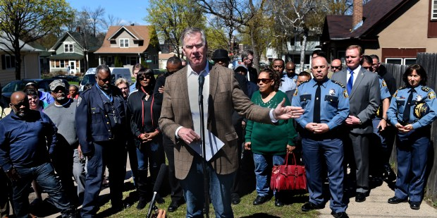 St. Paul Mayor Chris Coleman, center, and other officials speak out regarding recent gun violence in St. Paul on the corner of St. Albans Street and Fuller Avenue, the site of a recent homicide. They call upon the community to stand together against gun violence. Jean Pieri / Pioneer Press