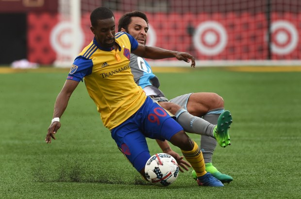 Colorado's Mohammed Saeid, left, and Minnesota's Ibson go after the ball in the first half as Minnesota United played the Colorado Rapids at TCF Bank Stadium in Minneapolis, April 23, 2017. Scott Takushi / Pioneer Press