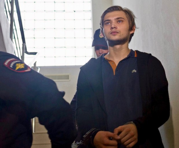 """In this Saturday, Sept. 3, 2016 file photo, handcuffed blogger Ruslan Sokolovsky is escorted by police officers in a court building in Yekaterinburg, Russia. Russian prosecutors are demanding that a blogger spend 3½ years in prison for playing """"Pokemon Go"""" in a church. The trial of Ruslan Sokolovsky wrapped up Friday, April 28, 2017 in the city of Yekaterinburg. The judge said a verdict would be issued May 11. (Vladimir Zhabrikov, file/Associated Press)"""