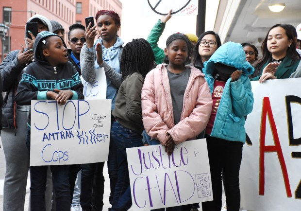 Youth gather to listen as Arterria Lipsey, the girlfriend of Chad Robertson, adresses a crowd of demonstrators outside the Amtrak station at Union Depot in St. Paul on April 5, 2017. Robertson was fatally shot by an Amtrak police officer near Chicago's Union Station in February, and the protesters had gathered to demand an apology from Amtrak. Nick Woltman/Pioneer Press