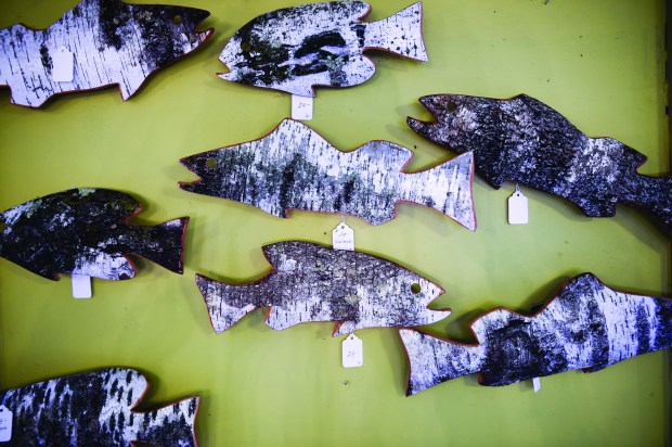 These fish carved out of birch by Bob Kernz can be found at Homespun Treasures in Lindstrom. Shown Thursday, April 13, 2017. (Craig Lassig / Special to the Pioneer Press)