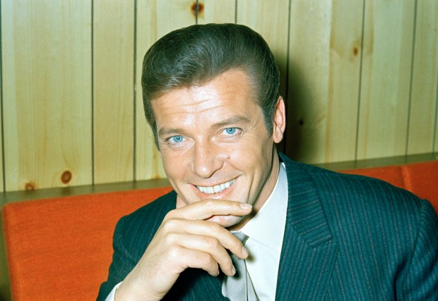 """This is a May 1968 photo of British actor Roger Moore of """"The Saint"""" and James Bond fame. Roger Moore's family said Tuesday May 23, 2017 that the former James Bond star has died after a short battle with cancer (AP Photo)"""