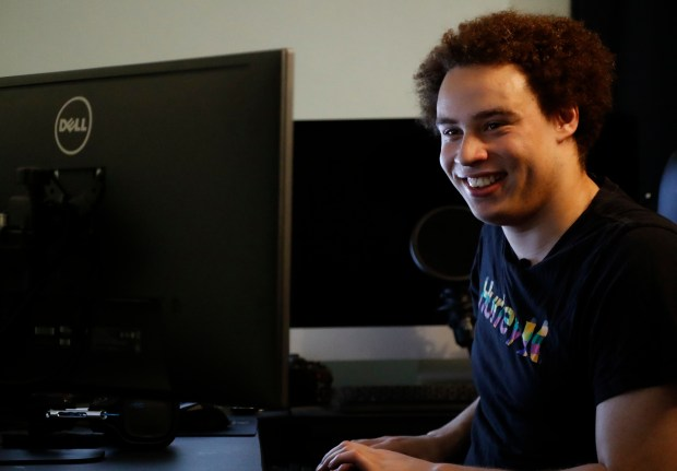 """CORRECTS FROM HUTCHIS TO HUTCHINS - British IT expert Marcus Hutchins who has been branded a hero for slowing down the WannaCry global cyber attack, sits in front of his workstation during an interview in Ilfracombe, England, Monday, May 15, 2017. Hutchins thwarted the virus that took computer files hostage around the world, including the British National Health computer network, telling The Associated Press he doesn't consider himself a hero but fights malware because """"it's the right thing to do.'' (AP Photo/Frank Augstein)"""