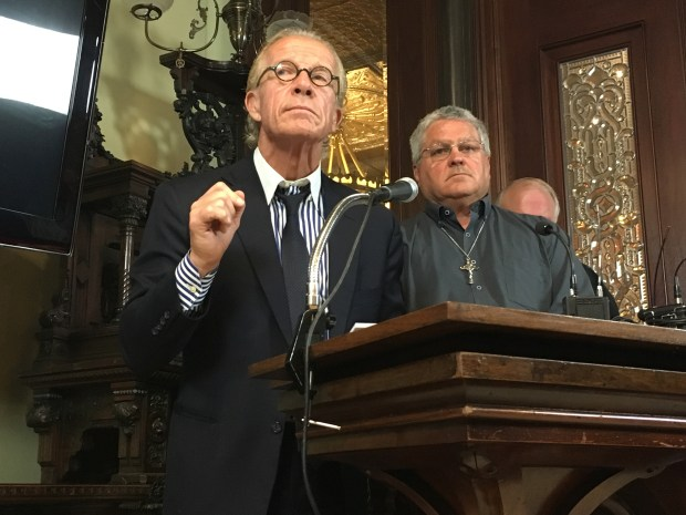 Attorney Jeff Anderson fields a question from the media during a news conference in St. Paul on Tuesday, May 9, 2017. His client, Ron Vasek (right), alleges he was sexually abused at the hands of The Rev. Roger Grundhaus during a trip to Ohio in 1971, when Vasek was 16 years old. (Robb Jeffries / Forum News Service)