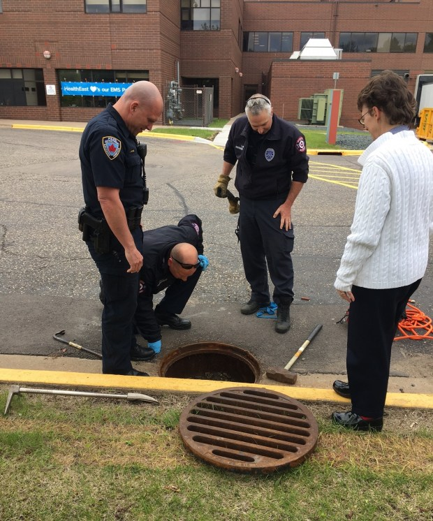 Maplewood Police officer Jay Wenzel (left) and Maplewood firefighters Chad Jansen and Timothy Linder come to the rescue. (HealthEast)