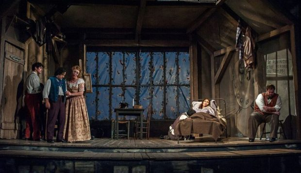 """In """"Rent,"""" she survives, but things are not looking so good here for bedridden Mimi (Nicole Cabell) in """"La Boheme"""" at Minnesota Opera. (John Grigaitis/Michigan Opera Theatre)"""