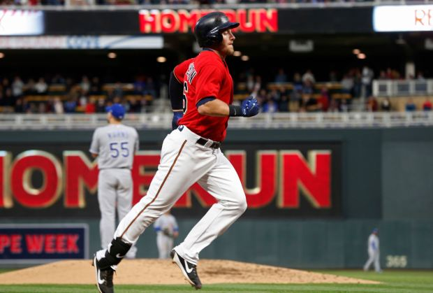 Minnesota Twins' Robbie Grossman jogs for home on a solo home run off Kansas City Royals pitcher Nathan Karns, left, during the fourth inning of a baseball game Friday, May 19, 2017, in Minneapolis. (AP Photo/Jim Mone)